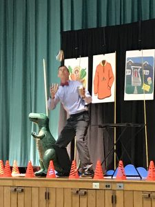 presenter tossing something into the air