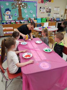 JHS student engaged in project with elementary students