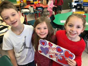 more students with heart decorations