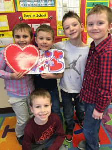 boys with heart decorations