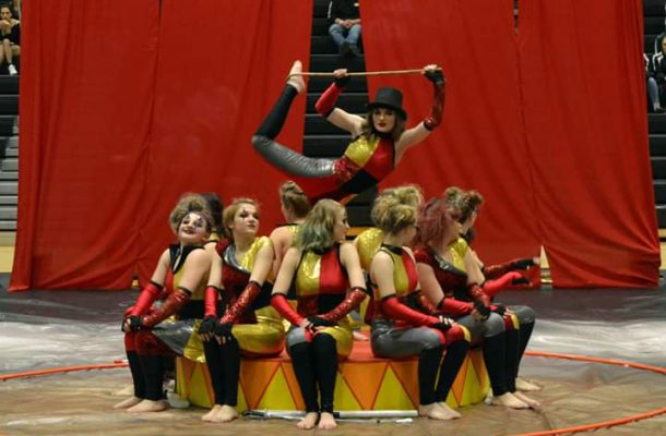 winter guard pose for a seated group photo