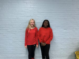 two students dressed in red