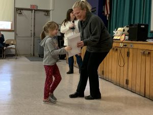 student receiving certificate from Principal Cotter