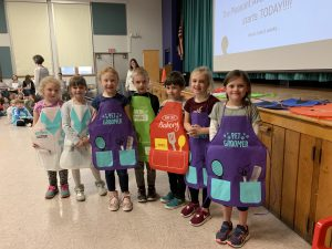 award winners dressed in colorful aprons