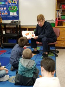 another woman reading to students