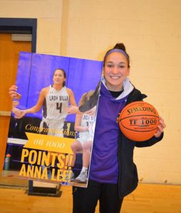 Anna with basketball and poster