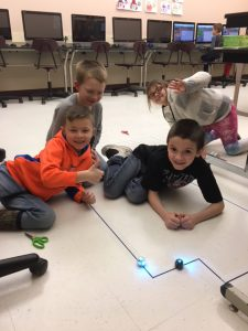 students working with ozobots