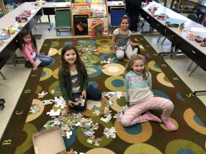 students with large puzzle pieces