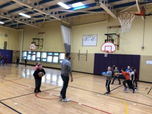 students shooting baskets