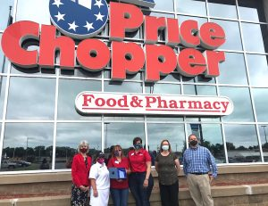 Price Chopper staff pose outside of the store