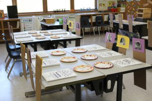 First grade teacher Catherine Knabe-Bikowicz set each student's assigned set in the classroom, with a Thanksgiving plate.