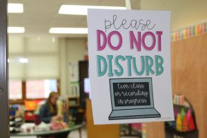 "A sign reading ""please do not disturb"" is shown on an elementary teacher's door."