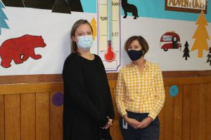 Pleasant Avenue Elementary AIS teachers Rachel Harrington and Nancy Lisicki - who both serve on the school's Literacy Committee - stand in front of a giant thermometer that will be used to track how many books have been read by Johnstown's K-2 students.