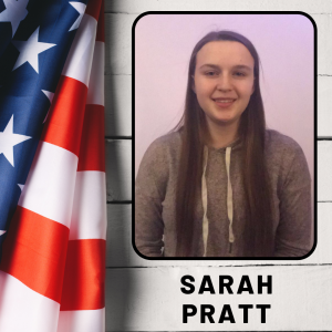 A girl smiling in an outdoor photo, next to an American flag, with her name listed, Sarah Pratt.