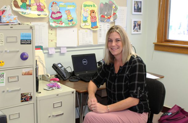 Licensed Clinical Social Worker Karyn Watson is shown sitting at a desk at her new office at Warren Street Elementary School.